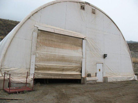 50 ft. X 70 ft. Coverall Building. c/w 2 Personnel Doors, 2 Roll Up Shop Doors, & Lights.