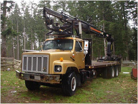 IRL International 2000 Series 2674. 21 ft. Deck, Cummins M11 330 HP Engine. Hiab 2640 Crane, Wired Remote. Max Reach 40 ft. 13,000 lb. Capacity. 40,000 lb. Rears. 18,000 lb. Fronts.