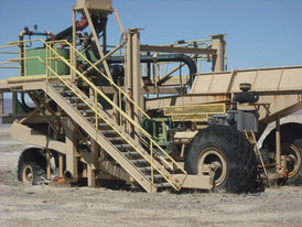 Gold Mining Placer Plant, Semi-mobile and mounted on earth moving tires.