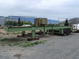 Low Boy Trailer. 10 ft. wide x 40 ft. long. 16 in. x 5 1/2 in. I-beam. Tandem Axle. Light and brake connectors. Walkways and hand rails.