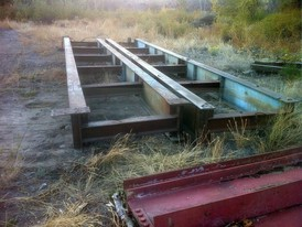 Used Steel. 5 ft. wide x 33 ft. long Bridge Frames. Constructed with 21 in. I-Beam.